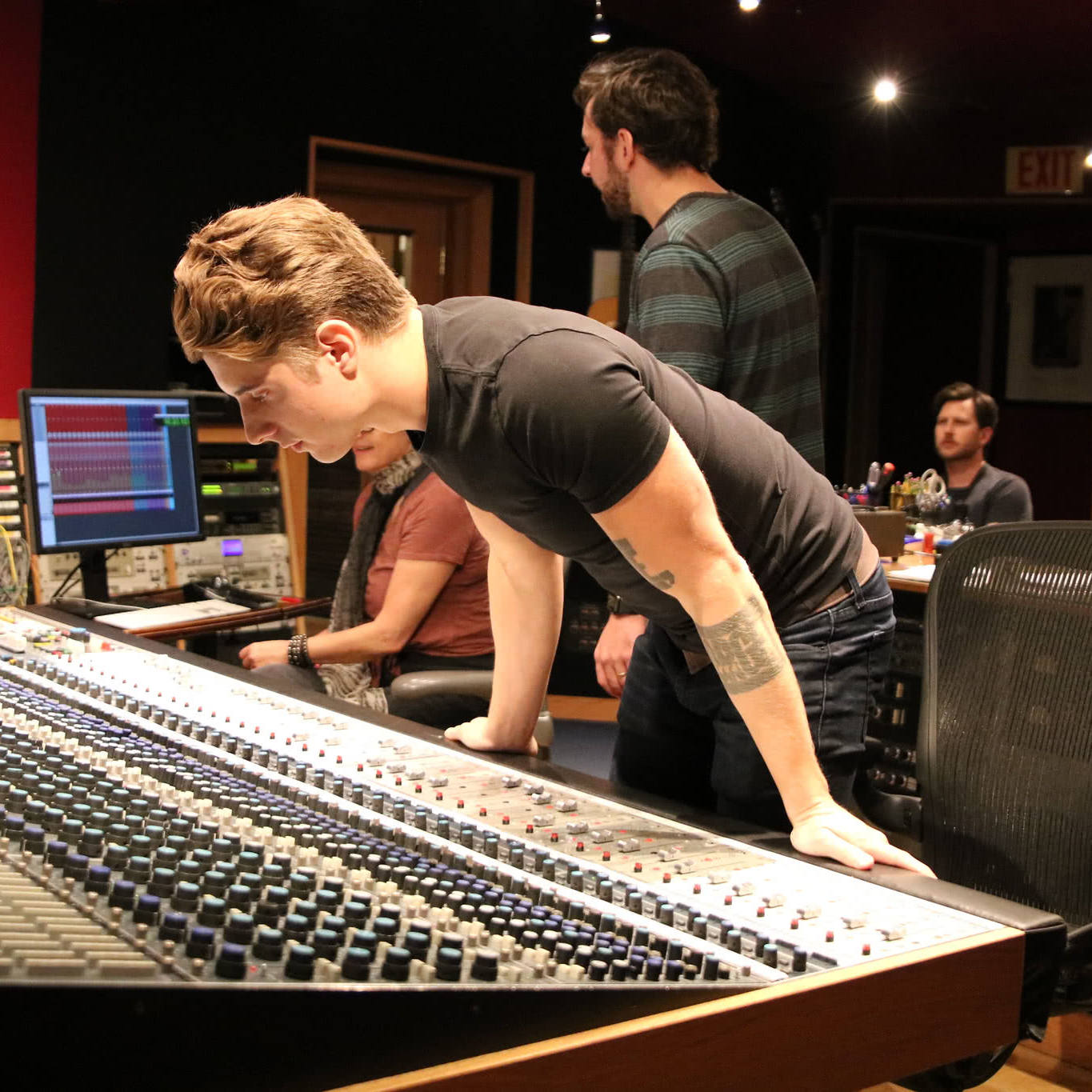 Student working at the Neve 8078 console in Studio A