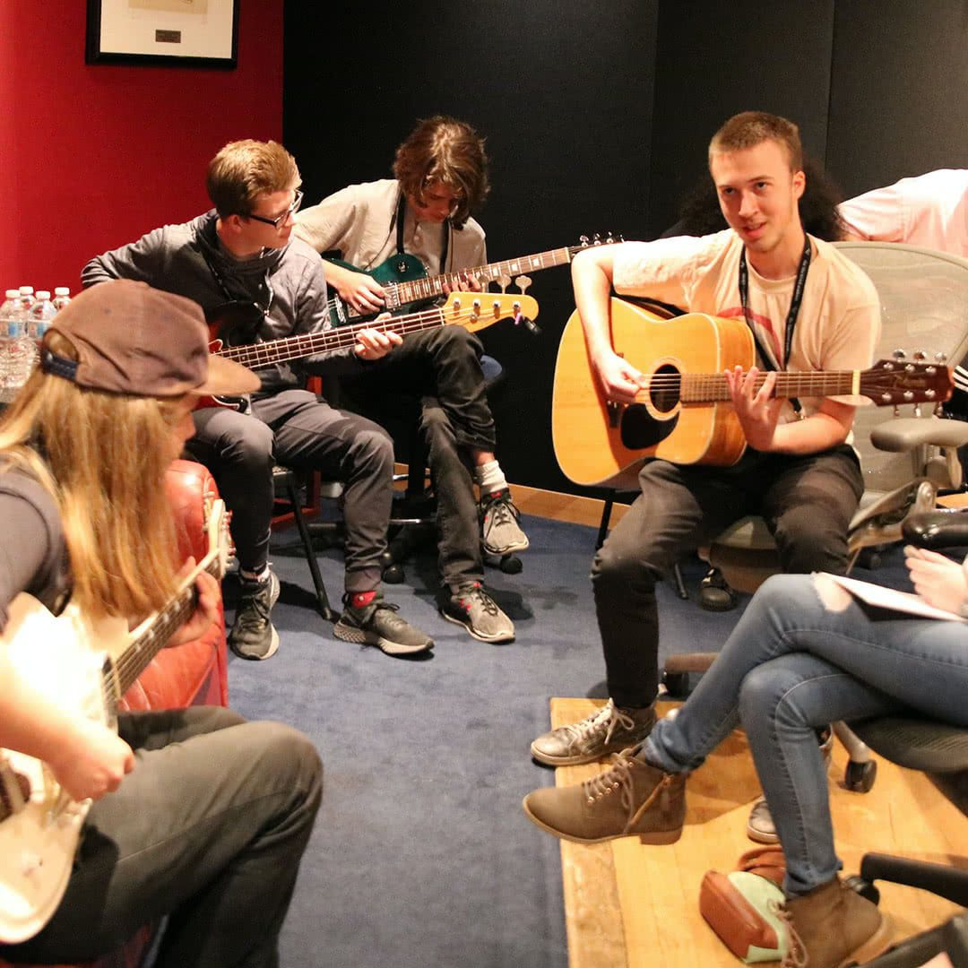 Campers with guitars