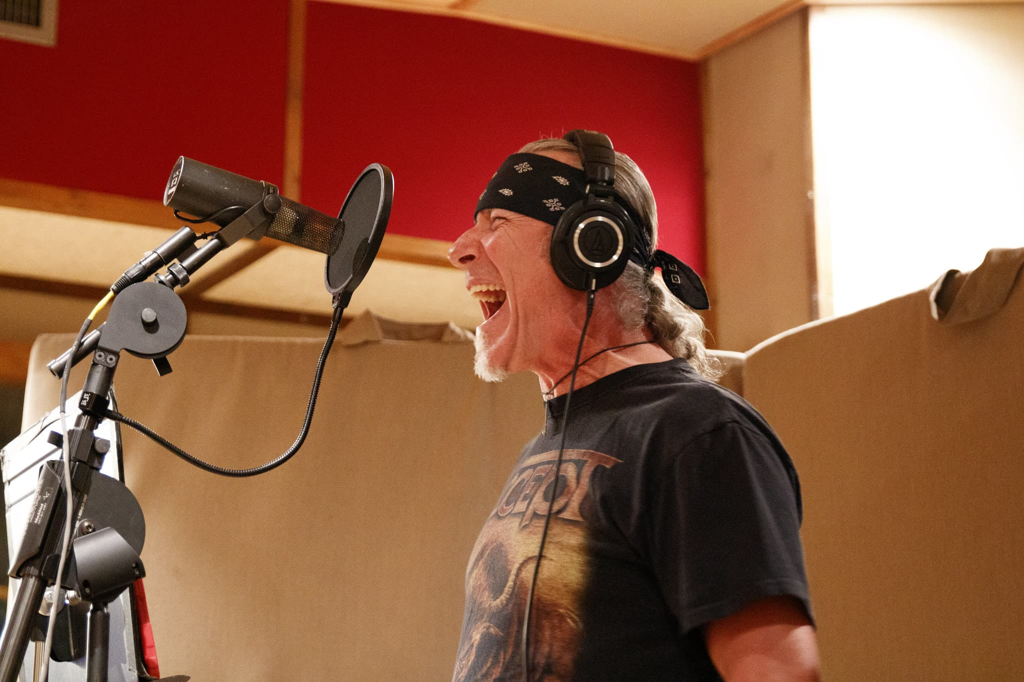 Charlie tracking vocals, singing into mic