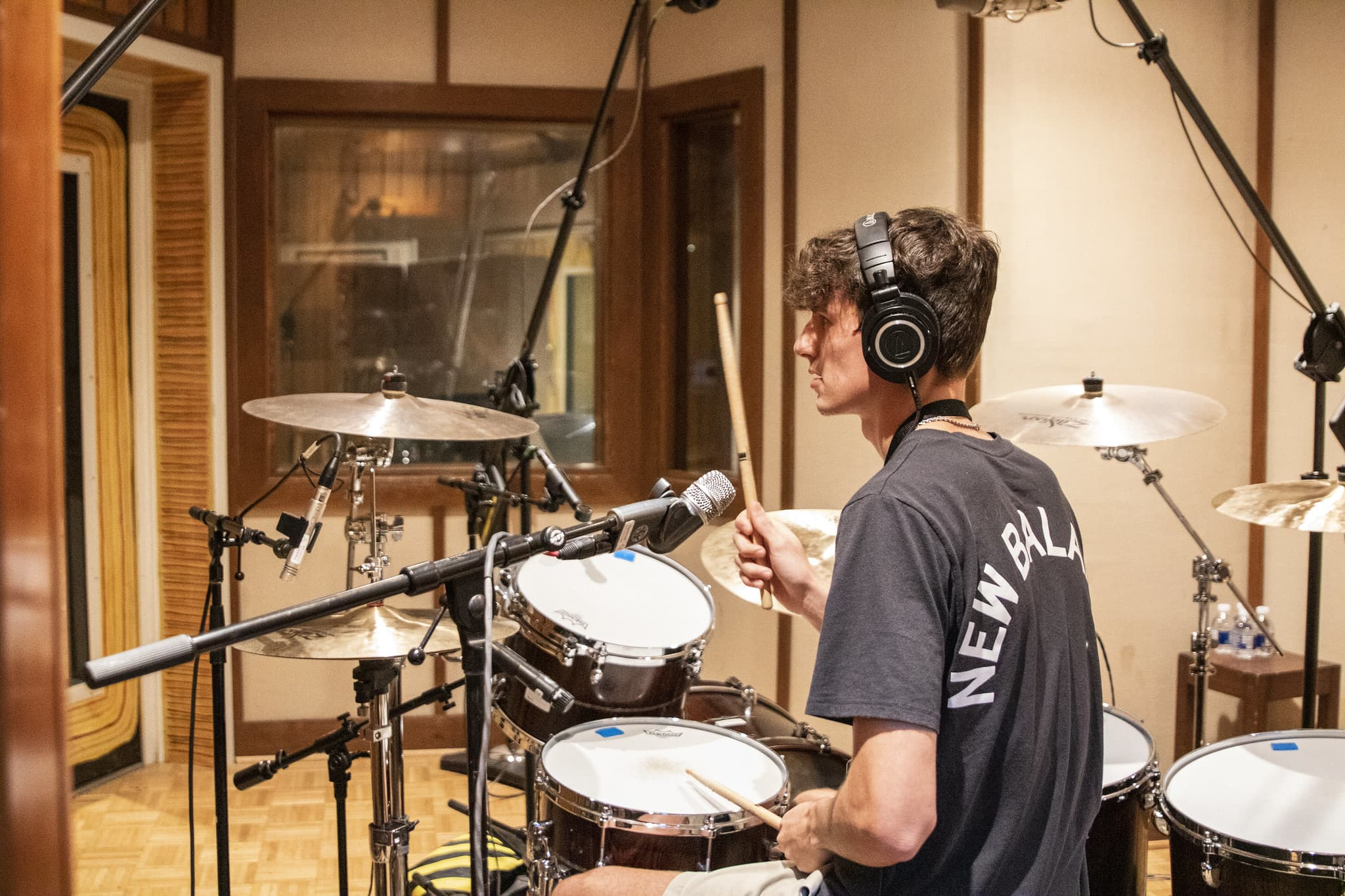 drummer in iso booth recording